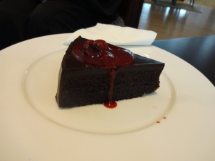Hyatt Regency's Sacher Torte with optional rasberry source.