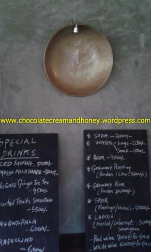 Their menu is written on black boards.